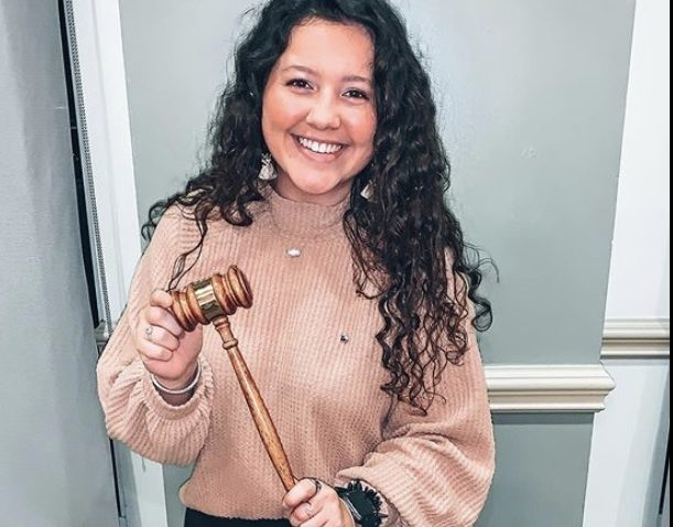 woman holding a gavel