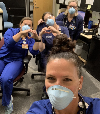 four nurses wearing masks