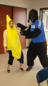 Dr. Gayle Lee, in a banana costume, jokes around with a colleague in a gorilla costume.