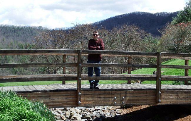 man on foot bridge