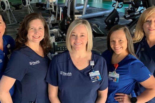 5 women in blue scrubs