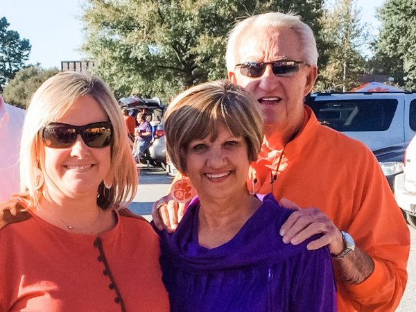 two women, one man in Clemson orange and purple