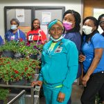 AU Health welcomes donations of Mother's Day flowers, milk vouchers for staff