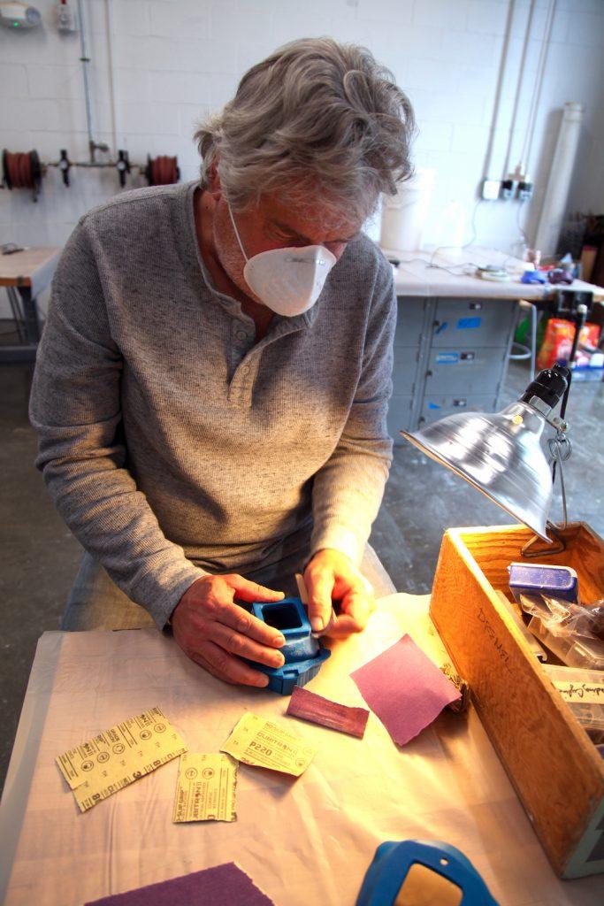 Man making molds.
