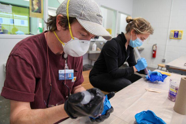 Team making face masks.