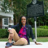 woman sits on sidewalk