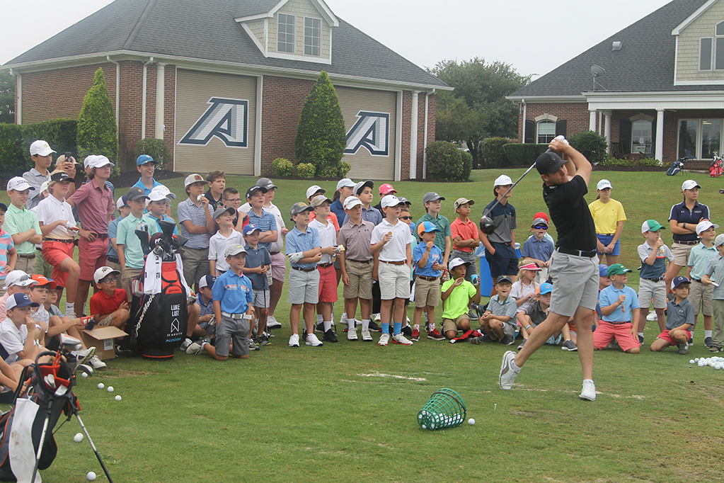 Kids watching golf