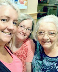 Three women looking at camera