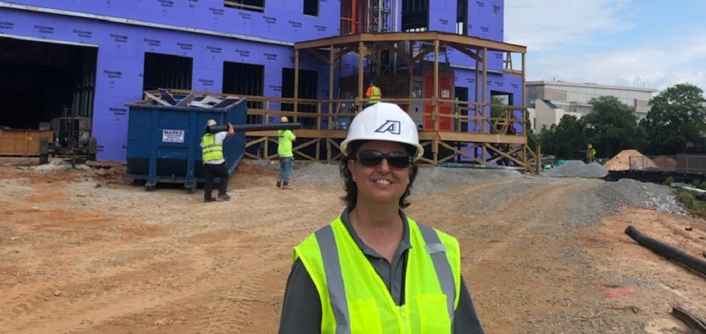 female in hardhat at construction site