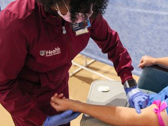A nurse preparing to draw blood.