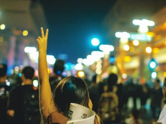 Woman raising the peace sign