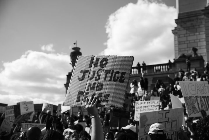 A person holding up a sign during a protest.