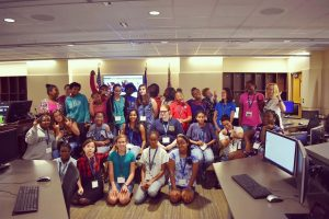 Middle and High school aged girls gathered for a group photo at a Girls Who Code meeting.