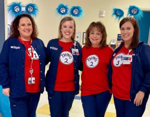 Four women dressed as Dr. Seuss characters