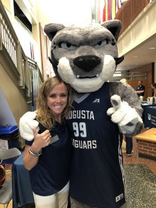Woman and jaguar mascot