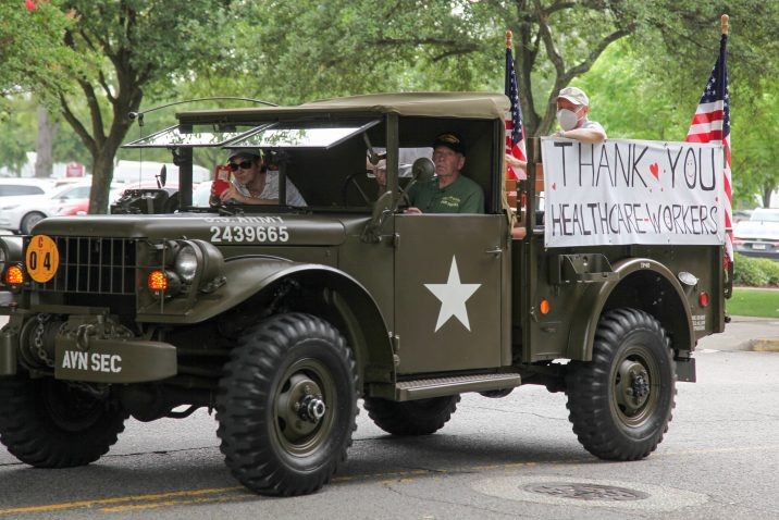 military truck with thank you healthcare workers sign