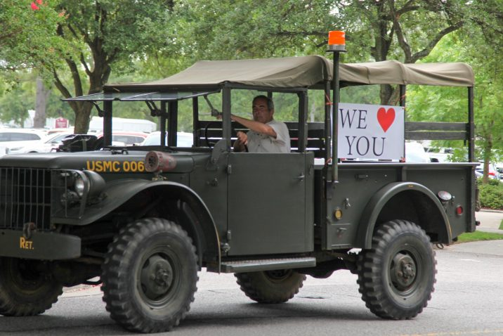 military truck with we love you sign