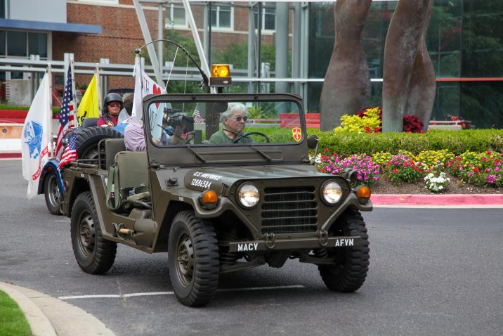man in military truck