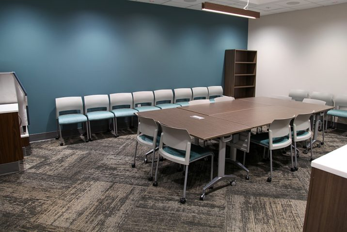 table and chairs in conference room