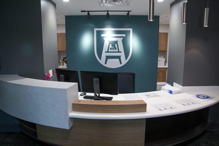 front desk with AU logo