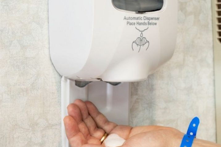 Wall Sanitizer Squirting Soap Into Hand