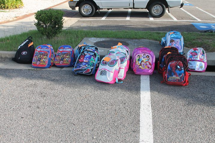 row of backpacks