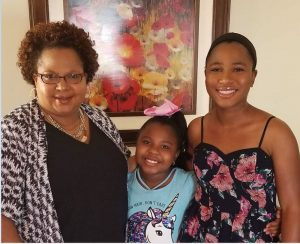 Johnson and her two daughters