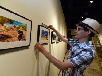 man hanging photograph