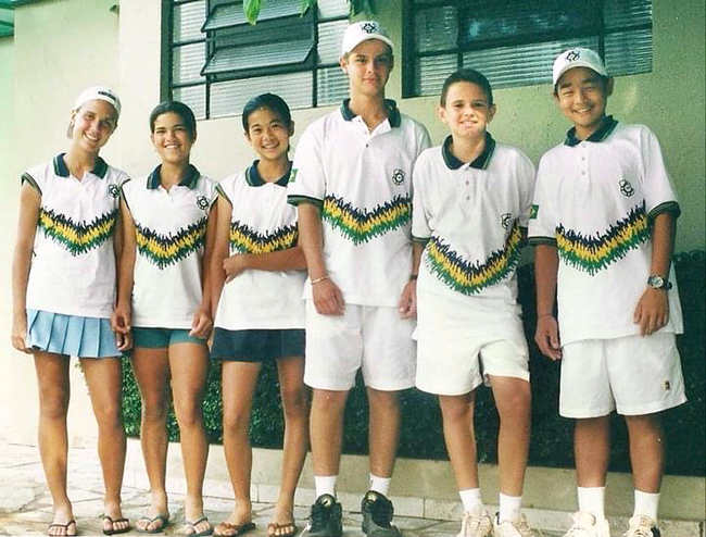Teen tennis players in uniforms