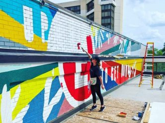 April Henry King paints mural
