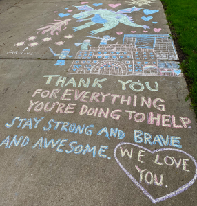 "Chalk art of a dragon over a hospital. Caption: ""THANK YOU FOR EVERYTHING YOU'RE DOING TO HELP. STAY STRONG AND BRAVE AND AWESOME. WE LOVE YOU."""