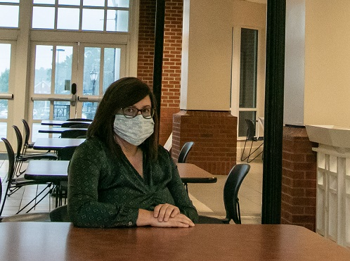 woman at table wearing mask