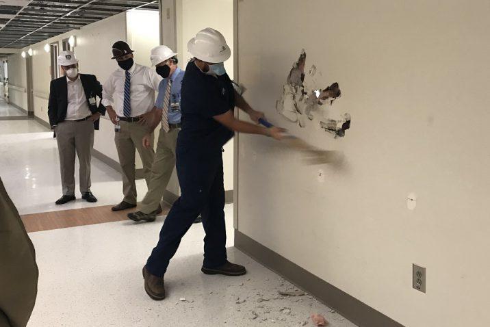 person hitting wall