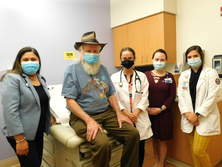 Group of doctors and patient