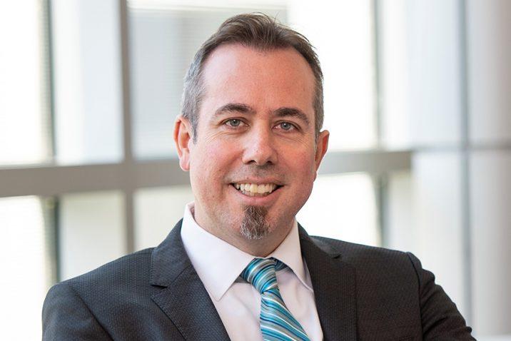 Dr. Neil J. MacKinnon