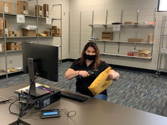 woman scans a mail package