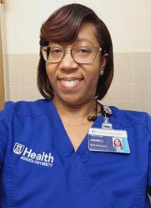 Woman in scrubs smiling