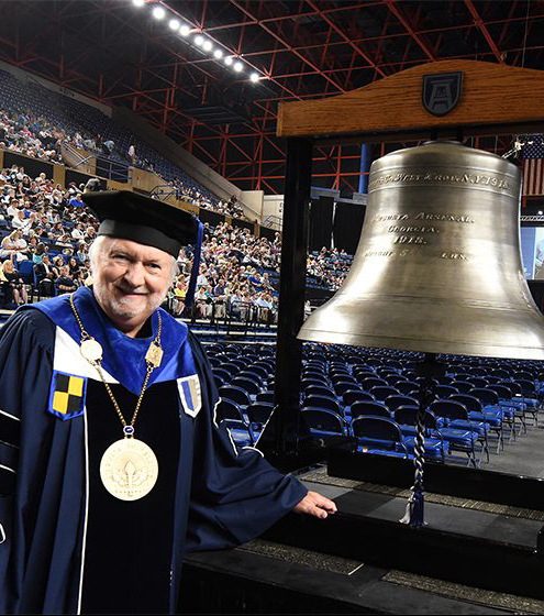 Man at graduation with bell