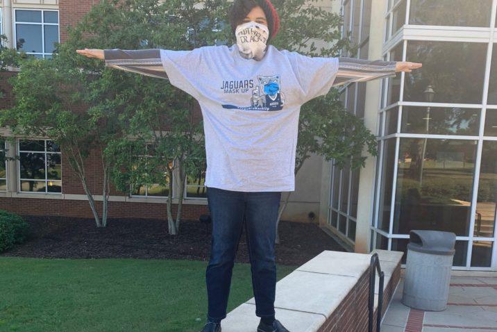 student wearing grey Jaguars Mask Up T-shirt