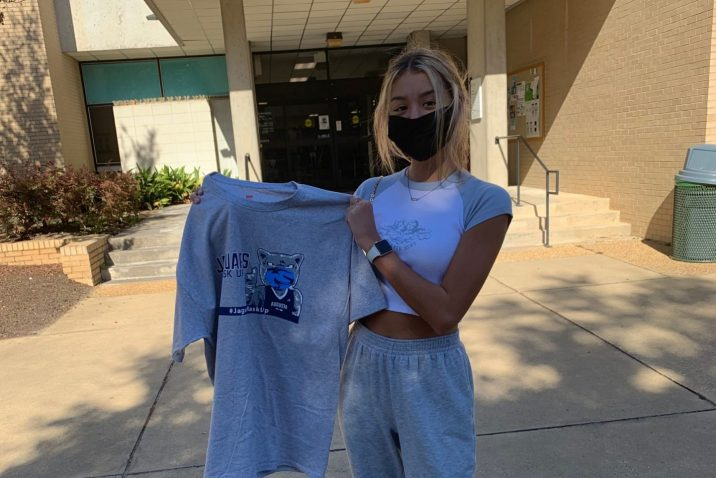 masked woman posts with grey Jaguars Mask Up T-shirt