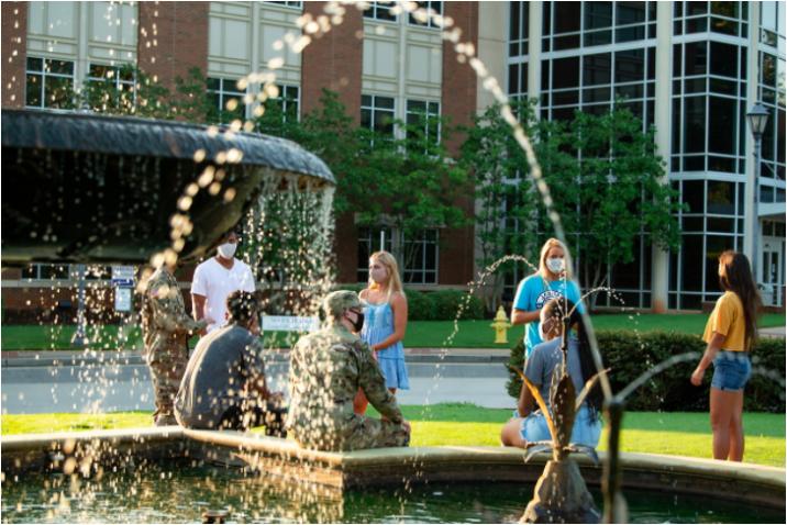 people standing near fountain