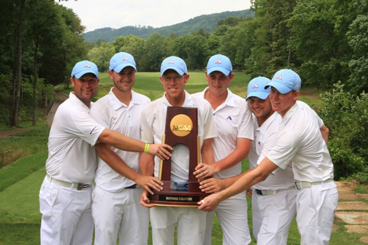 Golfers with trophy