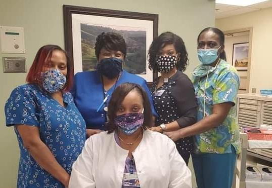 five nurses in scrubs