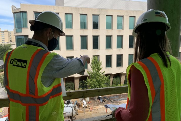 Two people looking at building