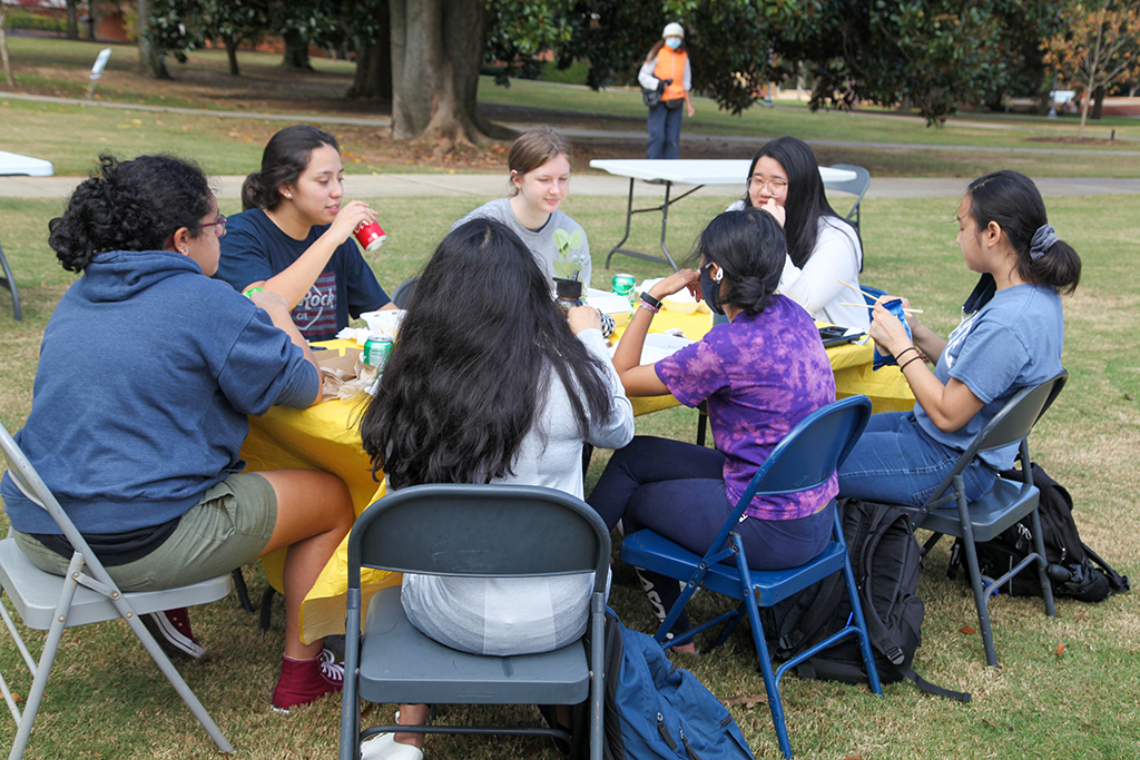 Students seated around a table
