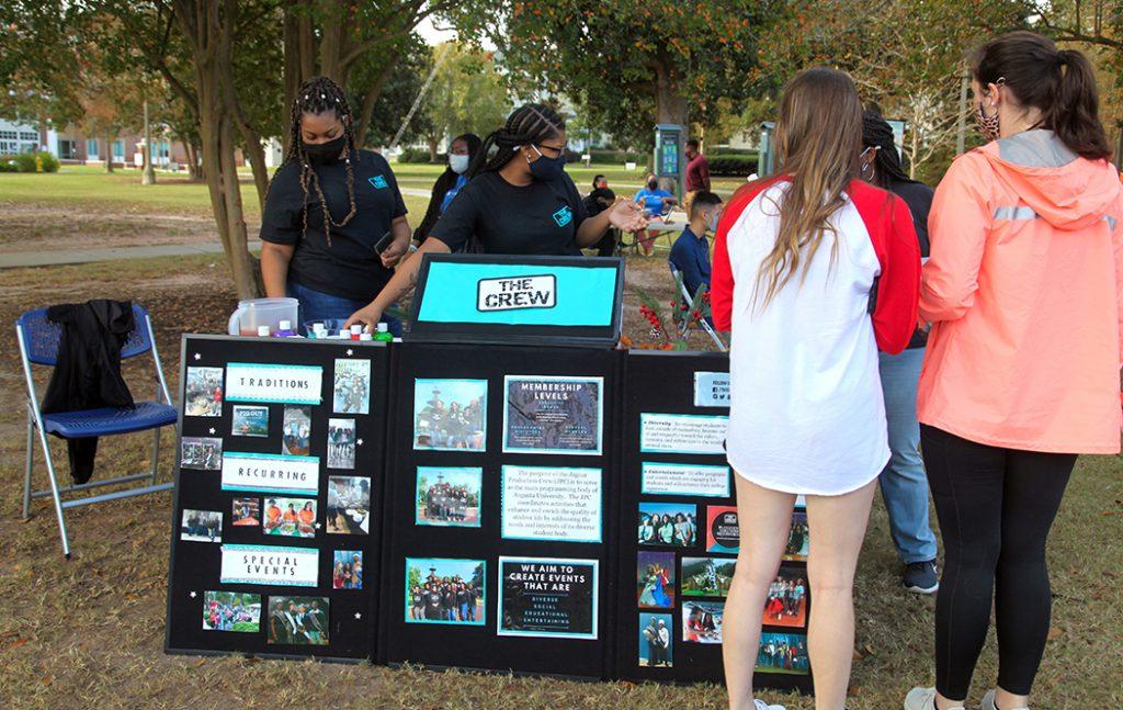 Students at photo display board