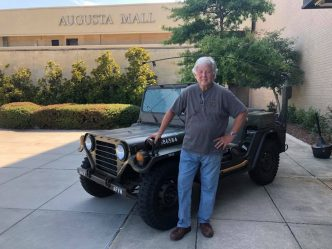 man in front of jeep