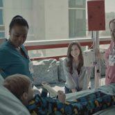 doctor, nurse, mom and kid in hospital room