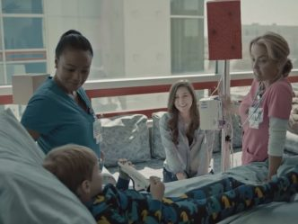 doctor, nurse, mom and kid in hospital room