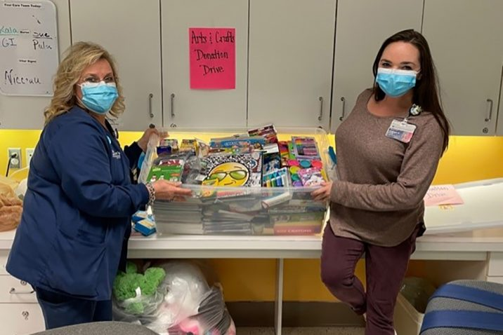 Two women with donated items